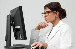 Radiologist at workstation